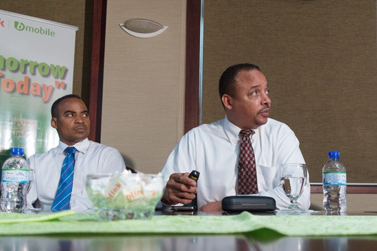 TSTT's George Hill (right), and Gerard Cooper, EVP Finance at the presentation to the media on the first year of the company's strategic plan. Photograph by Mark Lyndersay.