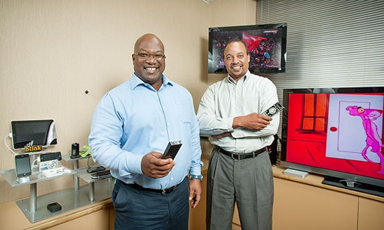 Ronald Walcott and George Hill, TSTT's men at the controls for the 4G introduction in the company's device display room. Photo by Mark Lyndersay.
