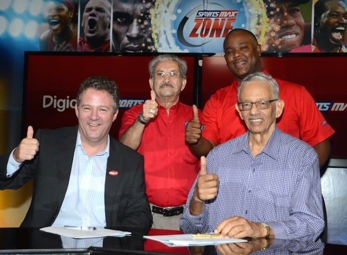 Digicel Group COO, Andy Thorburn, and Patrick Rousseau, Chairman of IMC and SportsMax (front row left and right)  celebrate with Phillip Martin, Deputy Chairman of IMC and Sportsmax (standing left) and Oliver McIntosh, CEO of Sportsmax (standing right).