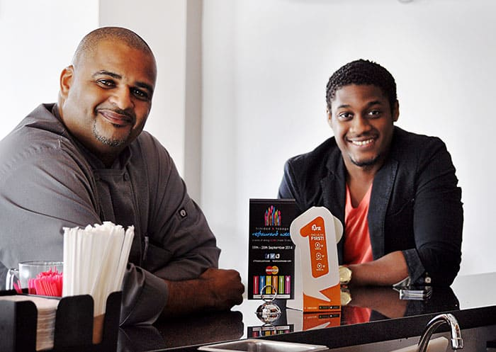 Jason Huggins, Flair Owner and Chef, and Kyle Maloney, F1RST.com Co-founder and Director, discuss T&T Restaurant Week. Located in Woodbrook at the corner of Taylor Street and Ariapita Avenue, Flair is participating in the 10-day event and will utilise F1RST.com as a tool for promoting the restaurant.