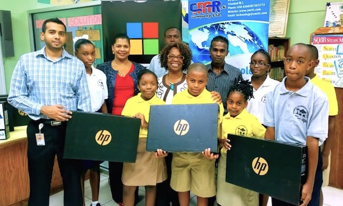 Some of the students at Eshe's Learning Centre are all smiles after receiving laptops from Microsoft and CMR & Company Limited. Included in the photo (l-r) are Yudhistre Vinni Jonas, Technical Evangelist, Microsoft, Monique Ragbir, Marketing Communications Manager, Microsoft, Kitts Cadette, Principal, and Gregory Ali, Technology Manager, CMR & Company Limited.