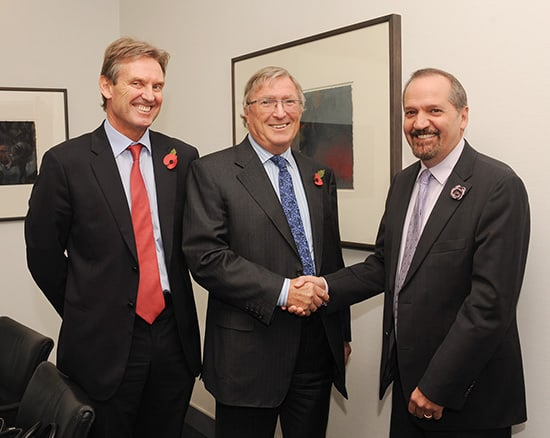 The handshake that rocked the Caribbean. Chairman of Cable and Wireless Communications (CWC), Sir Richard Lapthorne (centre) and Phil Bentley, CEO of CWC (left) congratulates Chairman and CEO of Columbus International Inc. Brendan Paddick following the announcement of the proposed merger between CWC and Columbus in London. Photo by Mark Shenley, courtesy Columbus.