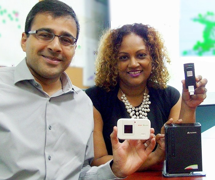 Reza Hosein and Allison Parris with the three ready-to-use 4G LTE devices available from blink | bmobile