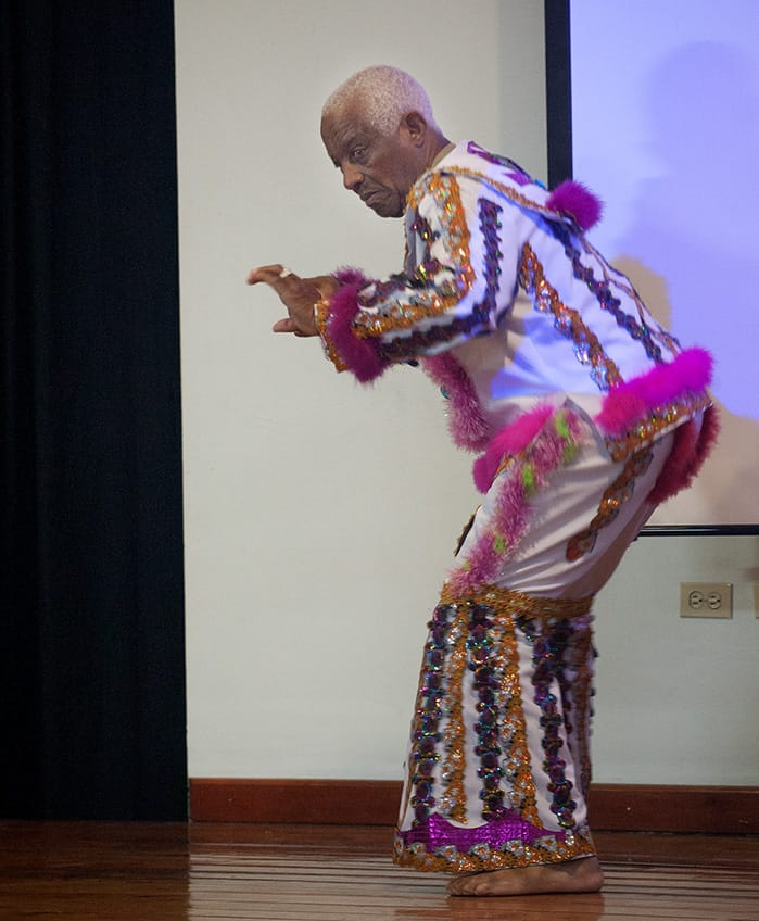 King Sailor Ralph Dyette explains the genesis of the masquerade's choreography at the 2015 Mas Colloquium. Photograph by Mark Lyndersay
