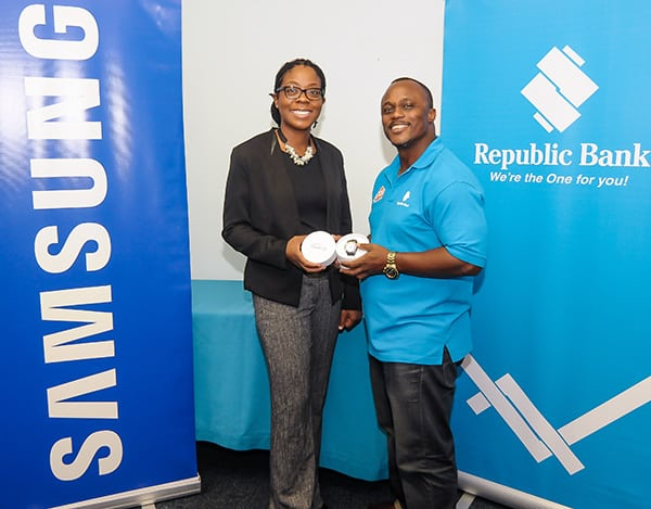 Above: Gracia Whyte, Samsung Electronics Trade Marketing Manager (T&T) and Shedley Branche Republic Bank Marketing Manager, Product Management, Credit, show off the new Samsung Gear S2 at Republic Banks' Park St Head Office. Photo courtesy Samsung.