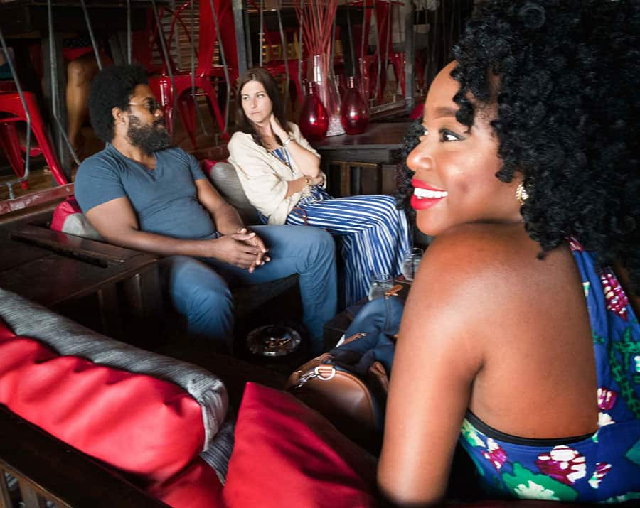 Marlon James (left) and Risanne Martin relax at the T&T leg of the Caribbean Bloggers Meetup at Drink Wine Bar. Photo by Mark Lyndersay.